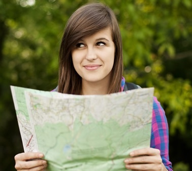 woman holding map and look to the side