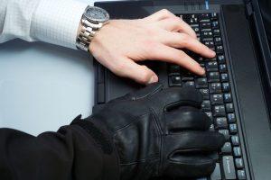 hacker on keyboard