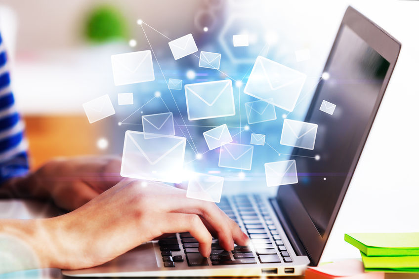 Hands using laptop with abstract email interface. E-mail networking concept. 3D Rendering